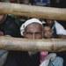 ত্রাণের শীতবস্ত্রের জন্য বালুখালি শরণার্থী শিবিরে রোহিঙ্গাদের অপেক্ষা।
