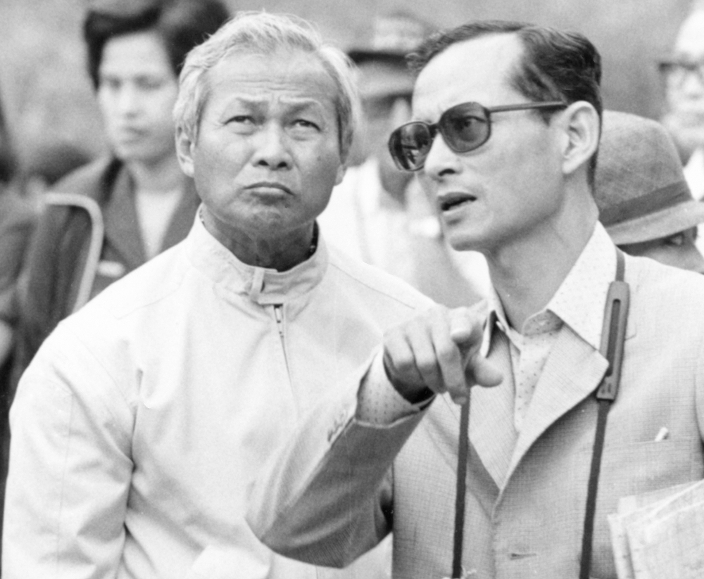 Thai King Bhumibol Adulyadej (right) talks with then-Prime Minister Prem Tinsulanonda during their visit to an irrigation project in northern Thailand, Feb. 16, 1981. [AP]