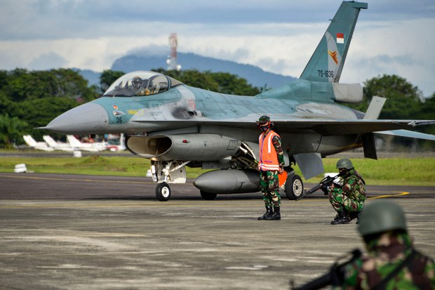 Soldiers hold positions next to an Indonesian Air Force F-16 during the Jalak Sakti military exercise at the Sultan Iskandar Muda Air Force Base in Blang Bintang in Indonesia's Aceh province, Sept. 8, 2020.