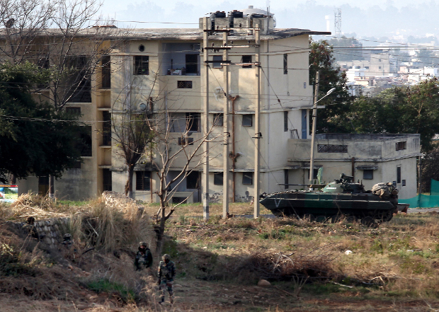 Indian Army soldiers take positions outside the residential quarters on the second day of a militant attack at Sunjuwan army camp in Jammu, Feb. 11, 2018.