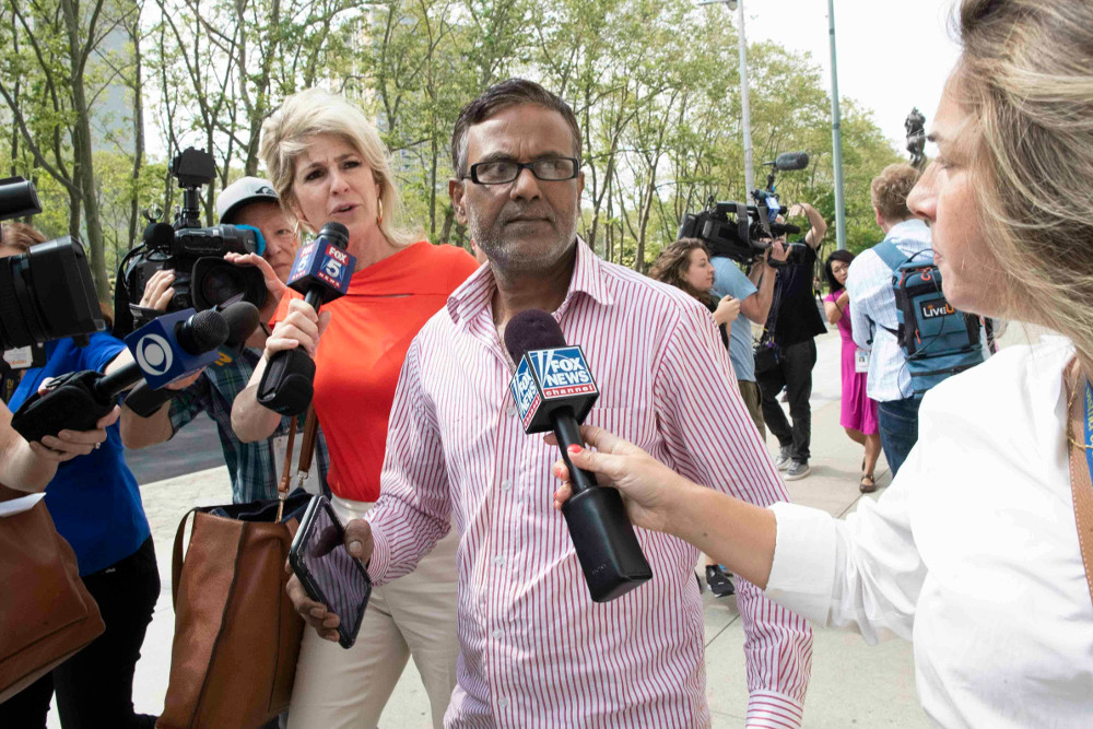 Reporters surround the father of suspect Ashiqul Alam as he leaves federal court in Brooklyn, N.Y., June 7, 2019. [AP]