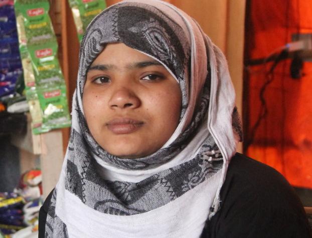 Literacy program founder Ali Johar's sister, Tasmida, is preparing for upcoming exams, March 11, 2019. [Rohit Wadhwaney/BenarNews]