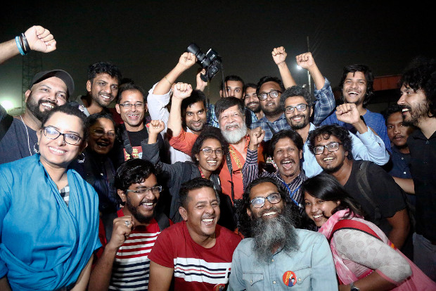 Supporters and friends cheer after Bangladeshi photojournalist Shahidul Alam received his temporary freedom and walked out of the Dhaka Central Jail, Nov. 20, 2018.