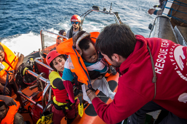 A baby is loaded into the rescue vessel of the Spanish NGO Proactiva Open Arms, after being rescued in the Mediterranean Sea at 45 miles from Al Khums, Libya, Dec. 21, 2018. [AP]