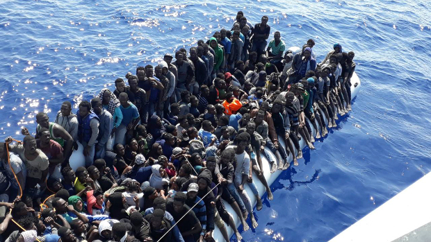 African migrants wait to be rescued while on board an inflatable rubber boat intercepted offshore near the town of Gohneima, east of the Libyan capital, Tripoli, June 24, 2018. [AP]