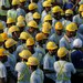 Workers from Bangladesh and India attend a briefing before starting work at a construction site in Singapore March 24, 2016.