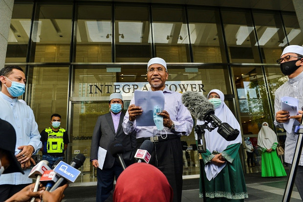 PAS vice president Idris Ahmad speaks to the media in front of the Integrate Tower in Kuala Lumpur, where the French Embassy is located, Oct. 27, 2020.