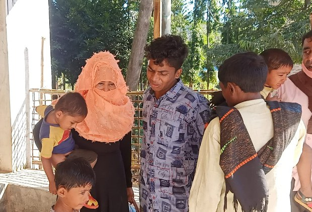 Omor Hamza (center), a Rohingya refugee in Bangladesh, cries as he says goodbye to his relatives before leaving Cox's Bazar for Bhashan Char Island, Dec. 3, 2020.