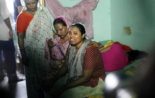 Ashamoni (center), the wife of Bangladeshi blogger Niladri Chottopaddhya, sobs at their home in suburban Dhaka following his murder there, Aug. 7, 2015.