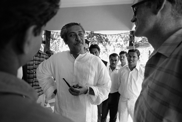 Sheikh Mujibur Rahman, leader of the Awami League, which seeks greater autonomy for East Pakistan, talks with followers in his home in Dhaka, March 14, 1971. (AP)