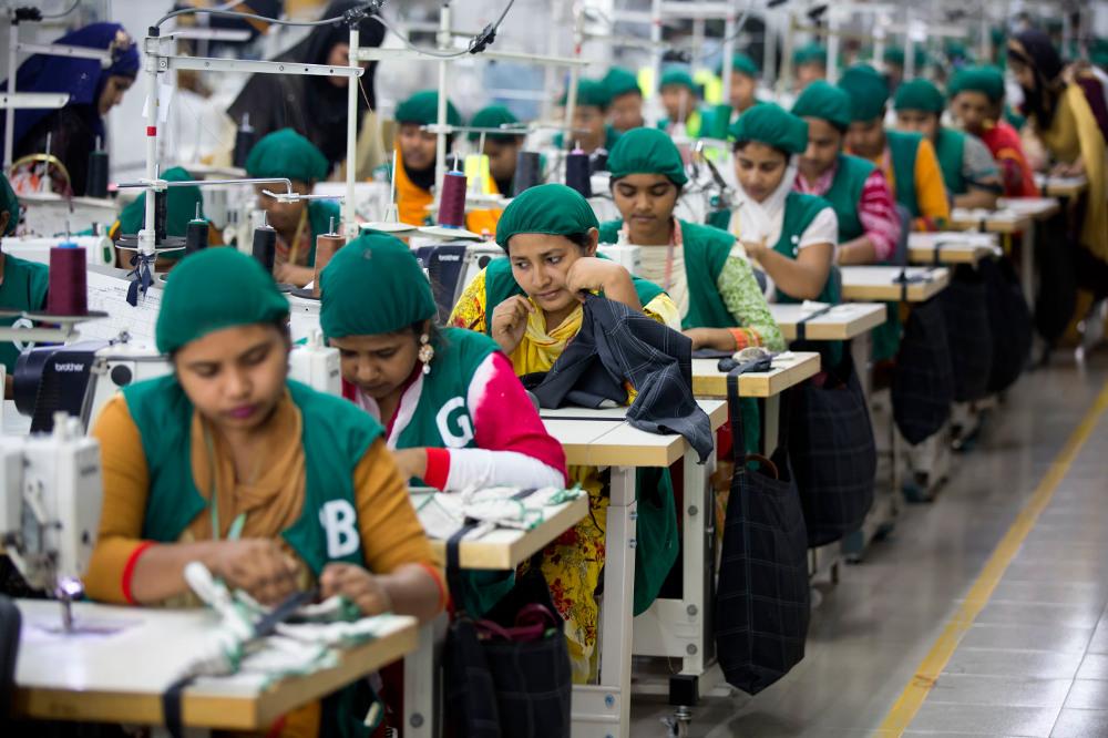 Trainees work at the Snowtex garment factory in Dhamrai, near Dhaka, April 19, 2018. [AP]