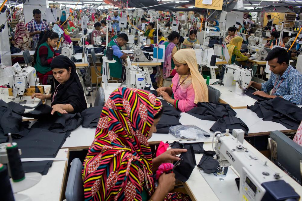 Bangladesh Garment Workers Face Long Workdays, Higher Living