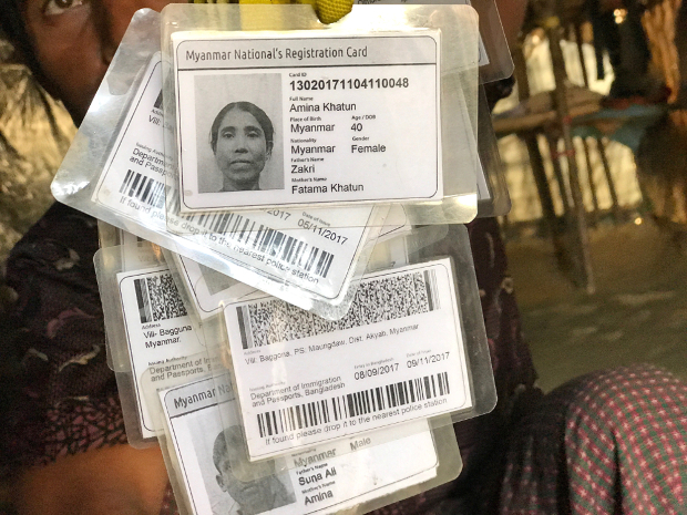 A Rohingya man holds identity cards Bangladesh issued to the Rohingya refugees upon their arrival in Cox's Bazar from Myanmar's Rakhine state, Jan. 21, 2018. [Kamran Reza Chowdhury/BenarNews]