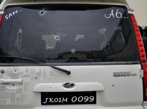 The rear hatch and window of the vehicle that carried Ghulam Nabi Patel show bullet holes following the fatal attack by unknown assailants, April 25, 2018. [Sheikh Mashooq/BenarNews]