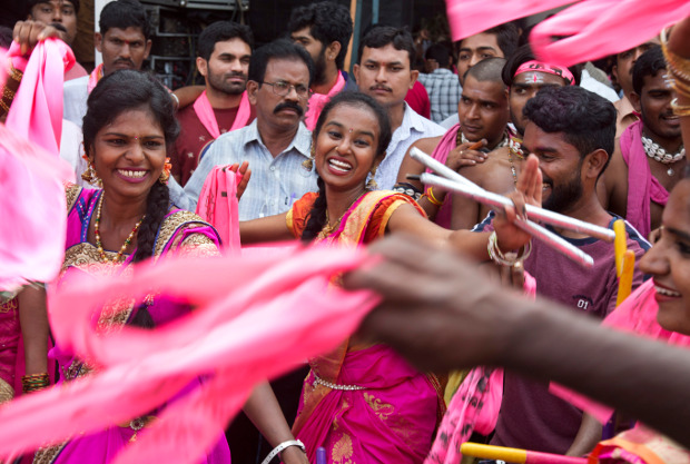 Supporters of Telangana Rasthtra Samathi (TRS) celebrate as trends indicate victory for the party in the Telangana State Assembly elections in Hyderabad, India, Tuesday, Dec. 11, 2018. [AP]