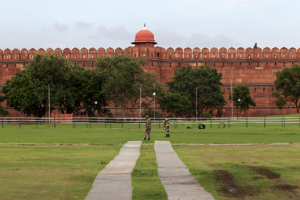 Indian soldiers stand guard near the Red Fort monument in New Delhi Aug. 14 2013.       AP