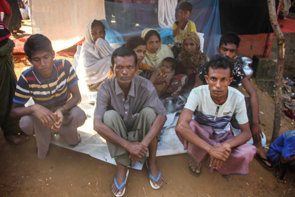 Mohammad Javed (right), a Rohingya refugee in Cox's Bazar, says his 11-member family barely gets by on one meal a day, Nov. 8, 2017. [Rohit Wadhwaney/BenarNews]