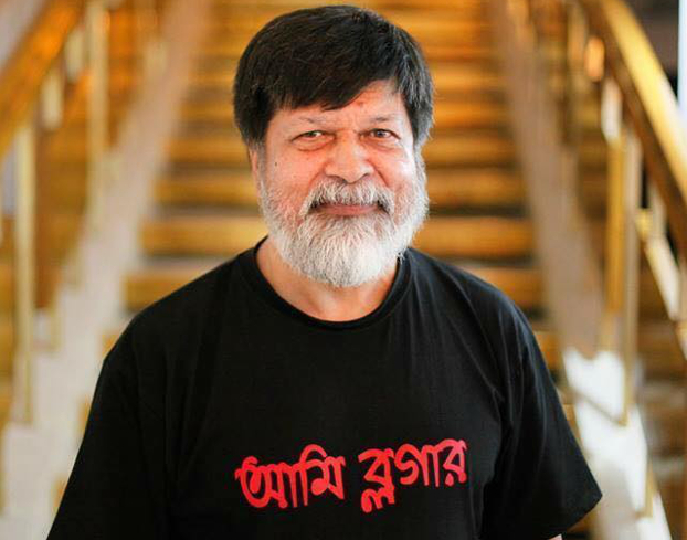 In this undated photo, Shahidul Alam wears a T-shirt that says 'I am a Blogger' in Bengali. [Courtesy Drik]