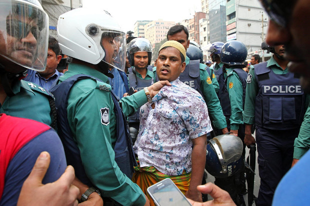 Police question a suspected demonstrator as hundreds of activists rallied to express their support for former Prime Minister Khaleda Zia in Dhaka, Feb. 9, 2018. [Monirul Alam/BenarNews]