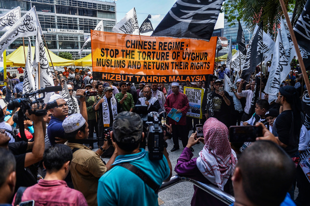 Members of Hizbut Tahrir Malaysia rally outside China's embassy in Kuala Lumpur to condemn the detention of Uyghurs in the Xinjiang region, Dec. 27, 2019. [S. Mahfuz/BenarNews]