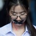 Thai student Nalinrat Tuthubthim, 20, who claims she was sexually abused by a teacher, has her mouth covered with tape as pro-democracy protesters accuse the government of corruption, Nov. 21, 2020.