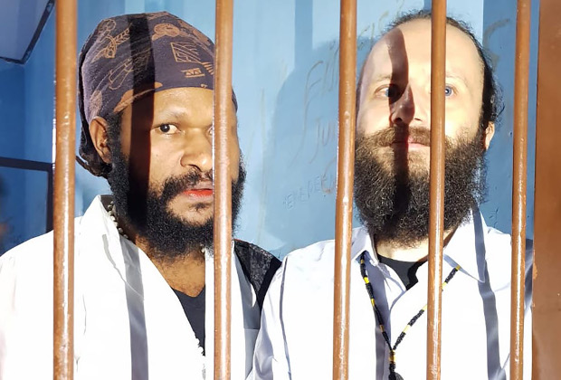 Jakub Fabian Skrzypski (right), and Simon Magal are seen in the holding cell at Wamena District Court in Jayawijaya, Papua, Jan. 14, 2019. (Courtesy of Latifah Anum Siregar)