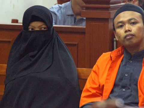 Dian Yulia Novi (left) sits next to her husband, Nur Solikin, during their trial at a court in Jakarta, Aug. 23, 2017. Dian was sentenced to seven-and-a-half years in prison for her involvement in an Islamic State-inspired plot to carry out a suicide bomb attack on the presidential palace.