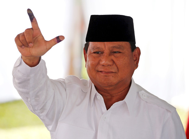 Indonesian presidential candidate Prabowo Subianto shows his ink-stained finger after casting his vote in Bogor, West Java, April 17, 2019. (Reuters)