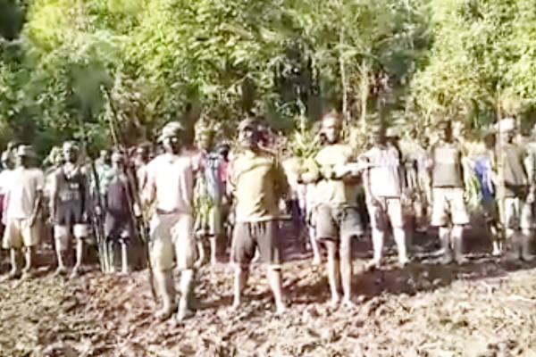 This photograph, grabbed from a video sent to BenarNews on Nov. 10, shows armed separatists training in the forest of Mimika Regency, Papua. [Victor Mambor/BenarNews]