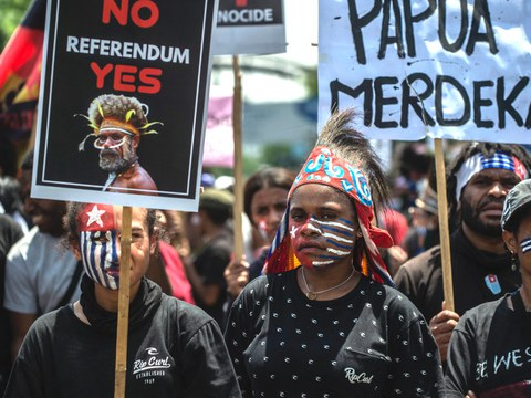 Papuan activists attend a protest in Surabaya to mark the Free Papua Organization's anniversary in Indonesia, Dec. 1, 2020.