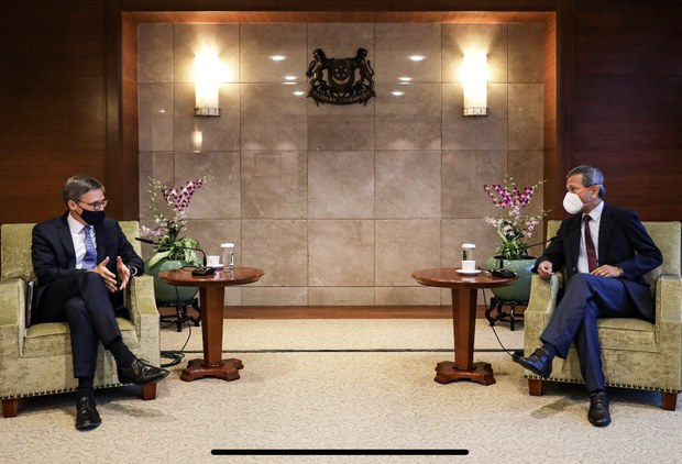 U.S. State Department Counselor Derek Chollet (left) speaks with Singapore Foreign Minister Vivian Balakrishnan, in Singapore, Oct. 20, 2021.