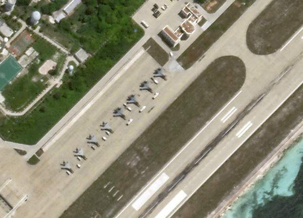 Eight fighter aircraft are visible on the Woody Island airstrip, China's largest settlement in the Paracels in the South China Sea, July 17, 2020. [Planet Labs Inc.]
