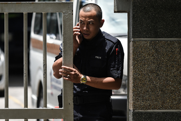 A Royal Malaysian Police officer stands at the main gate of the forensics wing of the Kuala Lumpur Hospital, which housed the body of Kim Jong Nam, March 29, 2017.