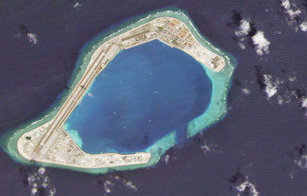 A satellite image taken Feb. 28, 2020 shows vessels at Subi Reef, an artificial island constructed by China in the Spratly island chain in the South China Sea. Chinese ships can only sustain their pressure campaigns far from mainland China if they can dock and replenish at such locations.