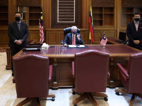 This handout photo shows Malaysian Prime Minister Ismail Sabri Yaakob sitting at his desk on his first day at the Prime Minister's Office in Putrajaya, Aug. 23, 2021.