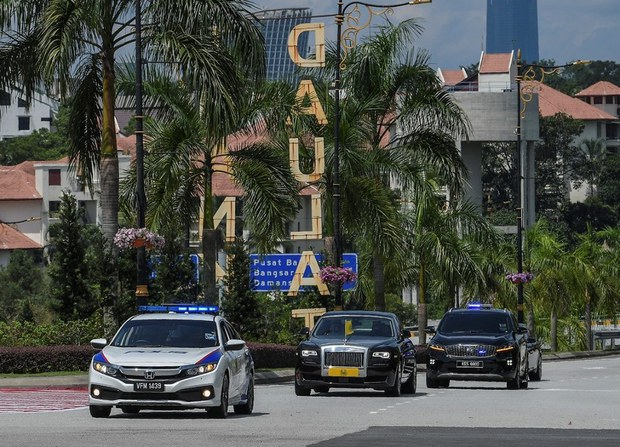 A limousine (center) carrying Al Aminul Karim Sultan Sallehuddin Sultan Badlishah, the ruler of Malaysia's Kedah state, approaches the National Palace in Kuala Lumpur ahead of a meeting there of the Council of Rulers, June16, 2021.