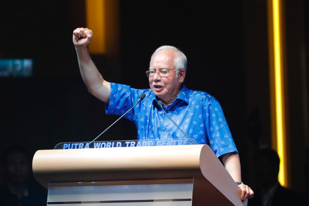 Malaysian Prime Minister Najib Razak, gestures during a speech to supporters of the ruling coalition in Kuala Lumpur, Jan. 3, 2018. [AP]