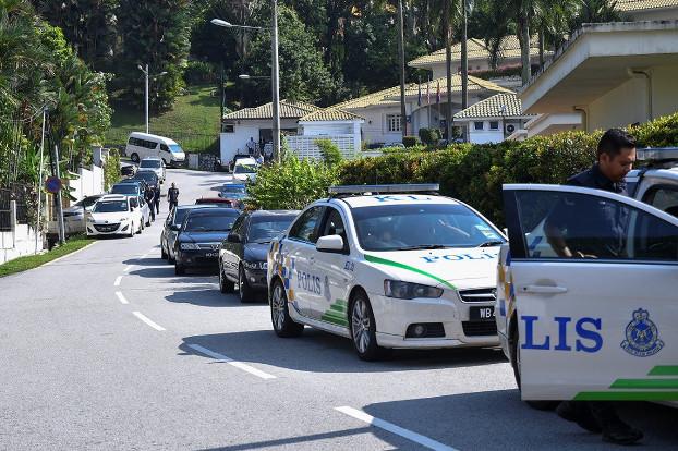 Police cars are seen outside the home of former Malaysian Prime Minister Najib Razak, at Jalan Langgak Duta in Kuala Lumpur, May 17, 2018. [S.Mahfuz/BenarNews]