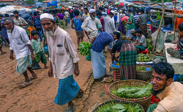 A Rohingya man (R) from Myanmar sells betel leaves at a market at the Kutupalong refugee camp in Ukhia, Cox's Bazar district, southeastern Bangladesh, July 21, 2019. AFP