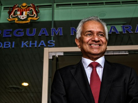 Tommy Thomas poses outside his office in Putrajaya after being appointed as Malaysian attorney general, June 6, 2018.