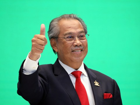Malaysia's Prime Minister Muhyiddin Yassin gestures during a virtual Asia-Pacific Economic Cooperation meeting in Kuala Lumpur, Nov. 20, 2020.