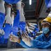 An employee inspects disposable gloves manufactured at the Top Glove factory in Shah Alam, on the outskirts of Kuala Lumpur, Aug. 26.