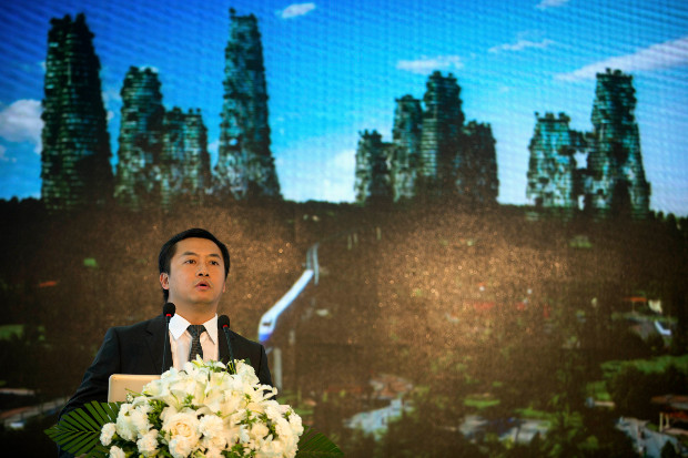 Huang Yuzang, vice president and chief developer at Country Garden, announces a competition offering prize money for an eco-friendly landmark piece of architecture for the firm's Forest City development in Malaysia, Aug. 13, 2016. (AP)