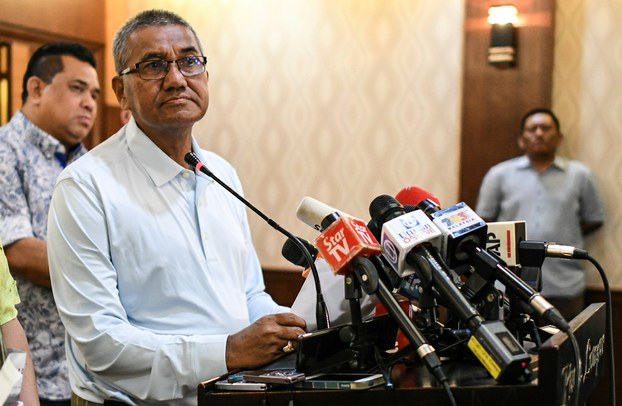 Malaysian Police Inspector-General Mohamad Fuzi Harun listens to questions during a press conference in Kuala Lumpur, April 22, 2018. [AFP]