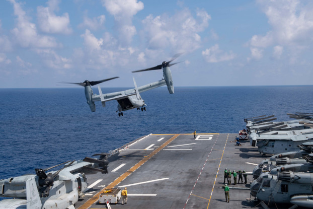 A U.S. MV-22B Osprey helicopter takes off from the USS America during operations in the South China Sea, April 19, 2020. [Petty Officer 3rd Class Jomark Almazan]