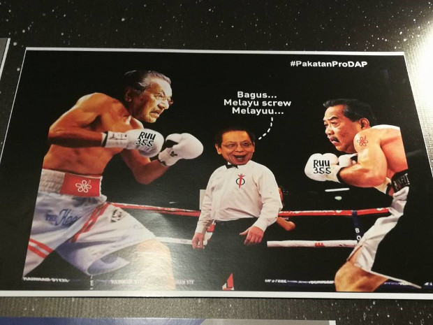 "This photo of a poster displayed at UMNO's annual assembly shows a caricature of ex-Prime Minister Mahathir Mohamad (left) boxing with former Deputy Prime Minister Muhyiddin Yassin as Lim Kit Siang, leader of the opposition Democratic Action Party, referees and says in Malay, ""Good! Malays screw Malays,"" Dec. 6, 2017. (N. Nantha/BenarNews)"
