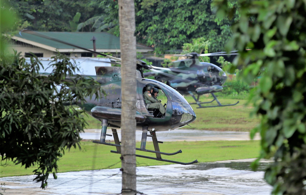 Two attack helicopters from the Philippine military reload missiles as their crews prepare to resume an assault on Abu Sayyaf militant positions Jolo island, an island in the southern Philippines, in April 2019. (Photo: Mark Navales/BenarNews)