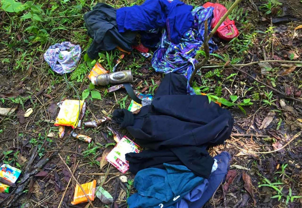 Personal items believed to have belonged to slain Dutch hostage Ewold Horn are seen at a militant camp after Philippine soldiers stormed the area in the jungles of Patikul on Jolo island, May 31, 2019. [Handout/Armed Forces of the Philippines]