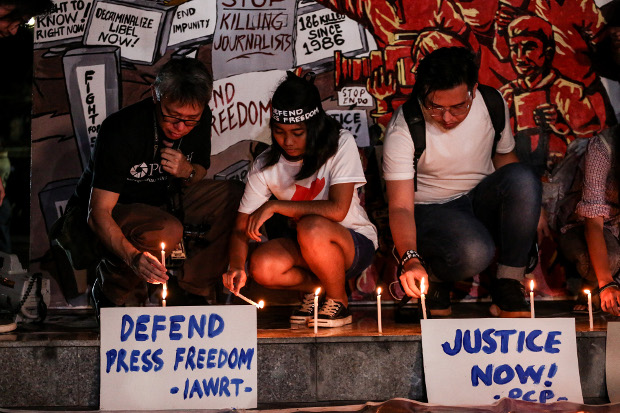 Filipino journalists and activists join a candle-lighting ceremony on the eve of the verdict in the Ampatuan Massacre case, in Quezon City, Philippines, Dec. 18, 2019. [Basilio Sepe/BenarNews]