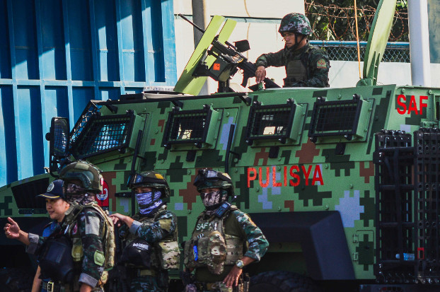 Philippine police man a Special Action Force anti-personnel vehicle during a security lock down at Camp Bagong Diwa, in preparation for the 2009 Ampatuan massacre verdict, Dec. 19, 2019. [Jojo Riñoza/BenarNews]